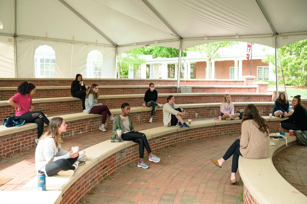 Socially distanced women's small group meeting in outdoor lecture space