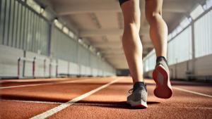 Closeup of runner's feet walking along indoor track